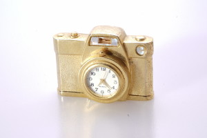 Gold Coloured Metal Miniature Clock With Quartz Movement Shaped as a Camera